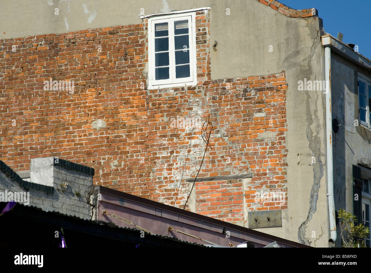 Window in a brick wall of a residential structure Stock Photo