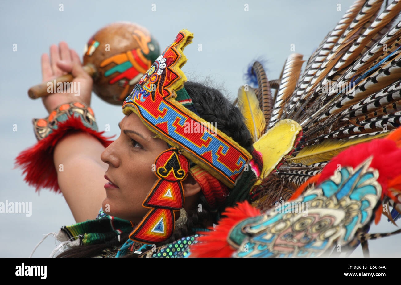An Incan South American Indian in a fancy feather headdress with arms up in worship at the Milwaukee Lakefront Indian - Stock Image