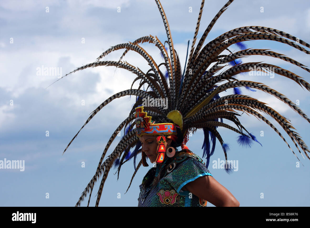 An Incan South American Indian in a fancy feather headdress at the Milwaukee Lakefront Indian Summer Festival Wisconsin - Stock Image