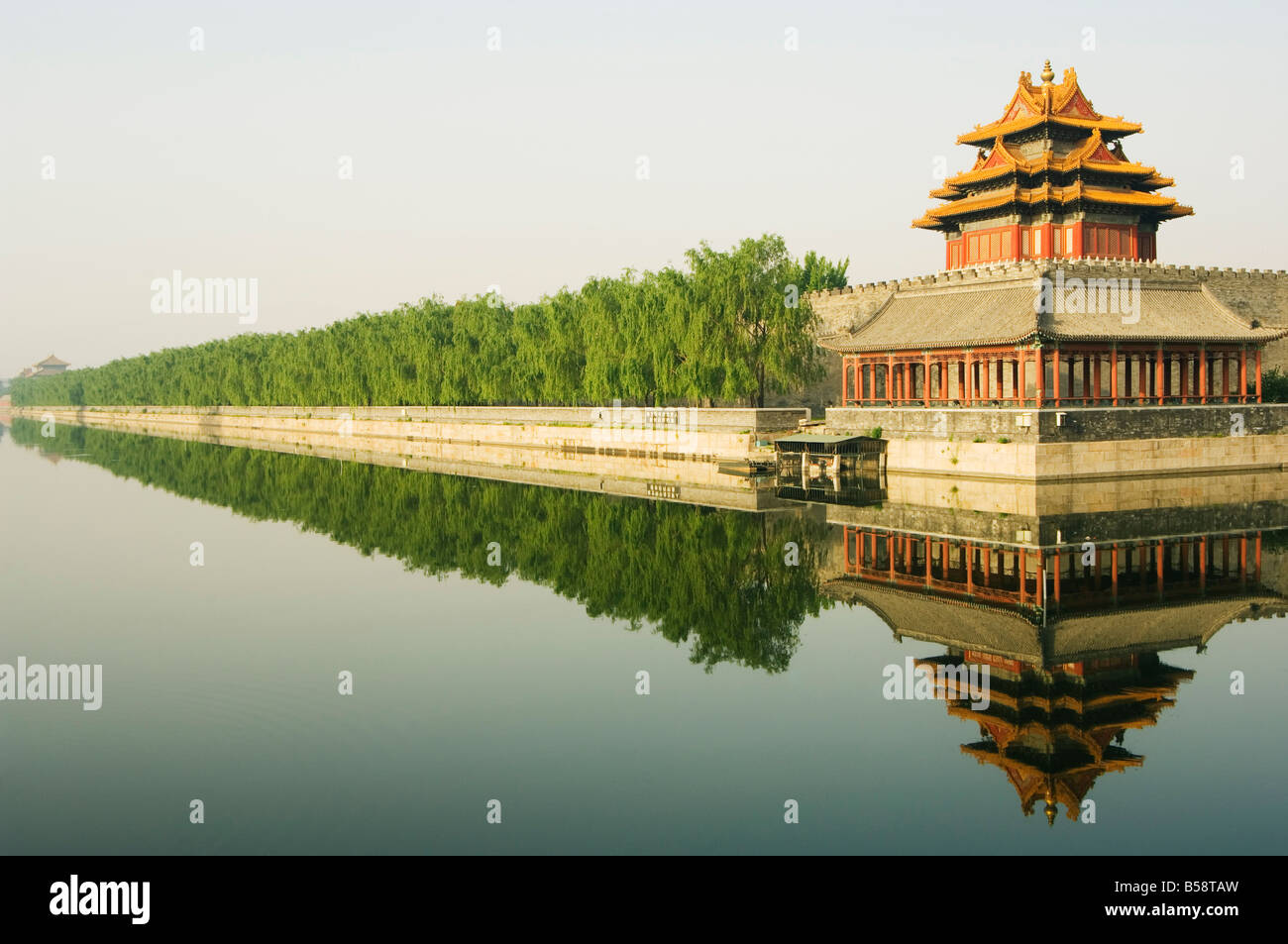 A reflection of the Palace Wall Tower in the moat of The Forbidden City Palace Museum, Beijing, China - Stock Image