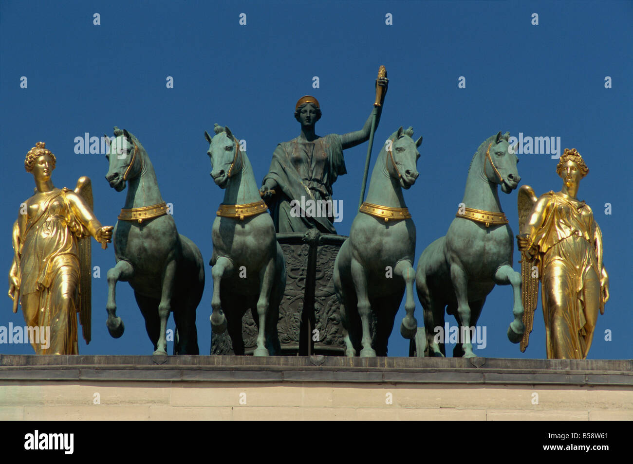 Gilded figures Caroussel arch Paris France Europe - Stock Image