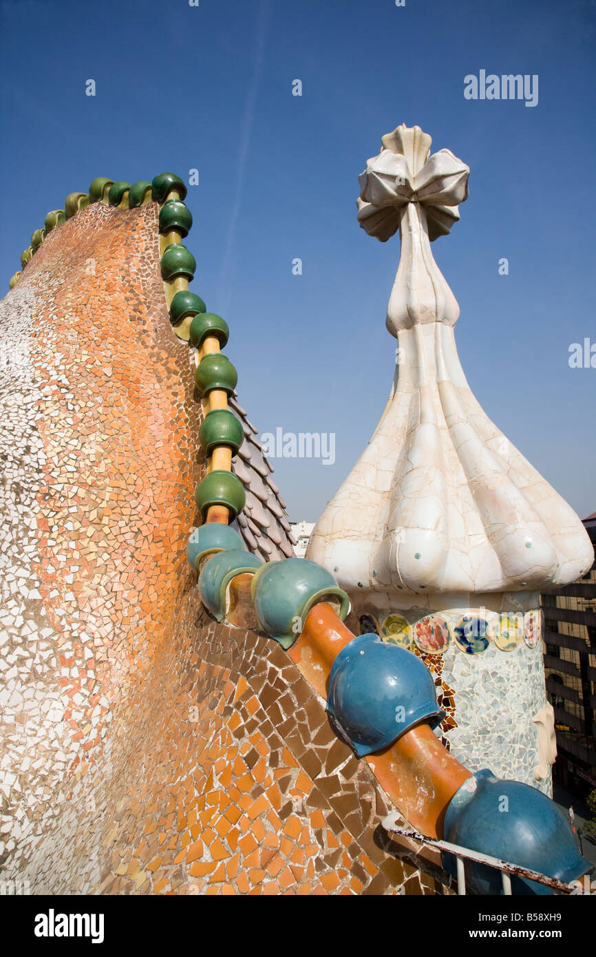 Bizarre chimneys and roof jut from the roof of Casa Batlló, Anton Gaudí's Modernist apartment house - Stock Image