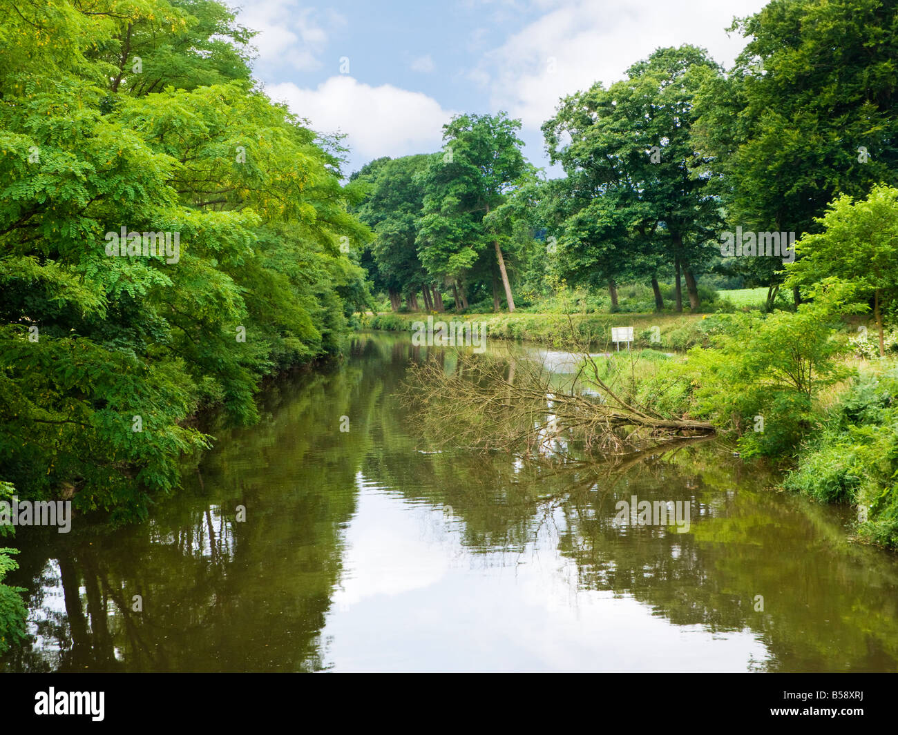 The picturesque Nantes Brest canal as it flows through rural Morbihan Brittany France Europe - Stock Image