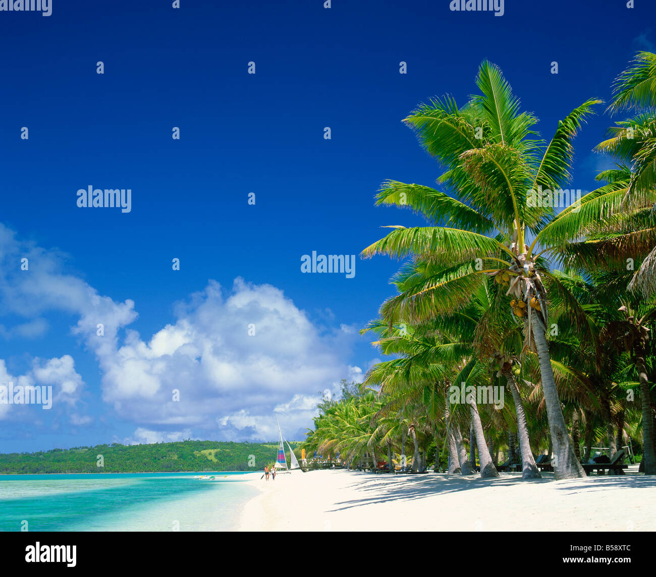 Tourists on the beach at Aitutaki in the Cook Islands Polynesia Pacific Islands Pacific - Stock Image