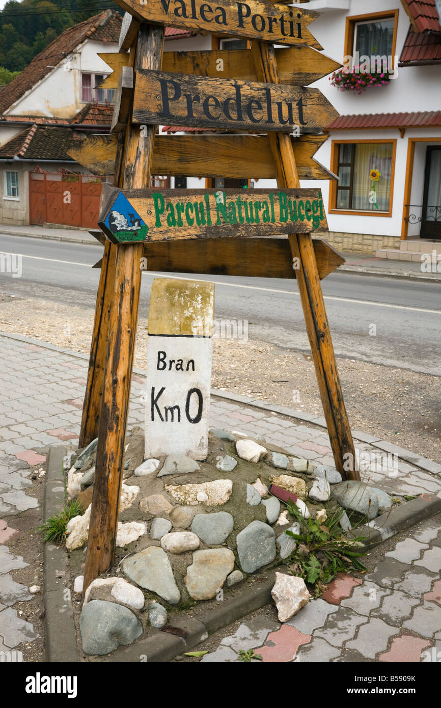 Bran Transylvania Romania Europe Old distance road sign with kilometers to village centre - Stock Image