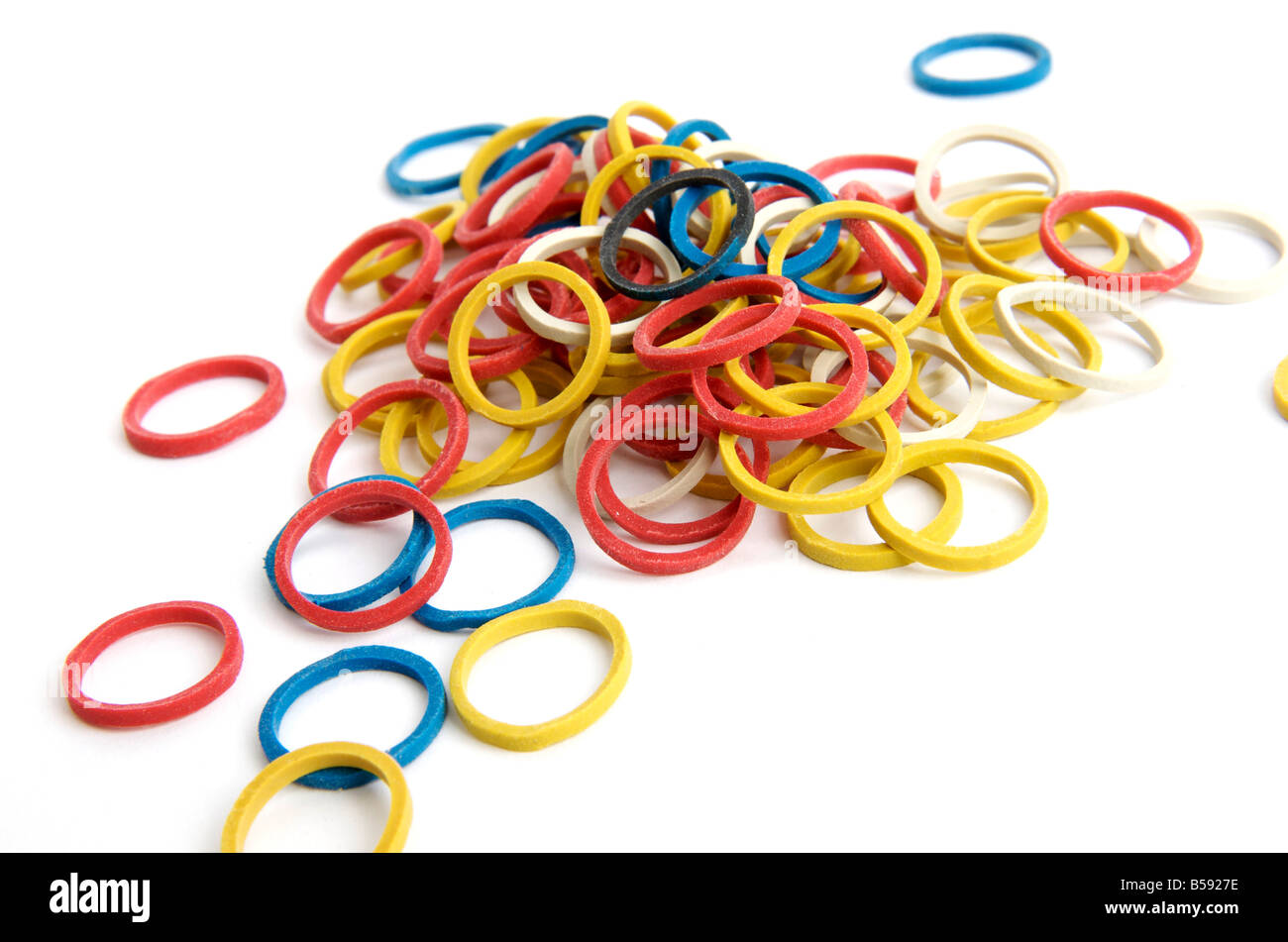 Heap of small multicolored rubber / elastic bands - Stock Image