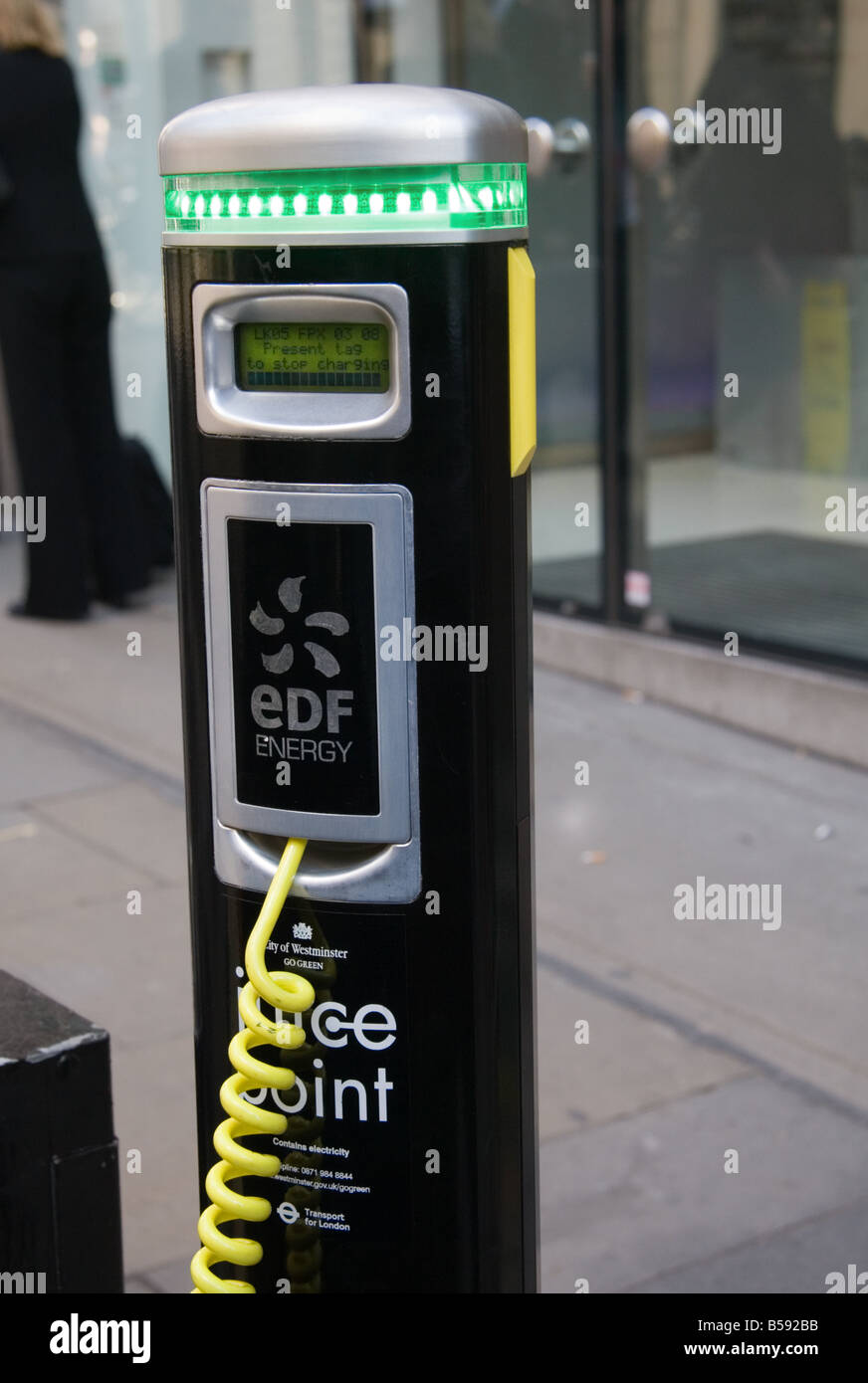 An EDF electric car battery re-charging point in use, Covent Garden, London, UK - Stock Image