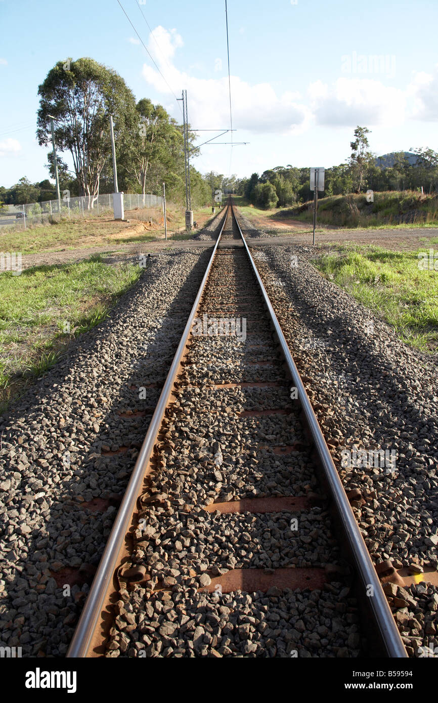 Railway line receding into the distance in Queensland QLD Australia - Stock Image