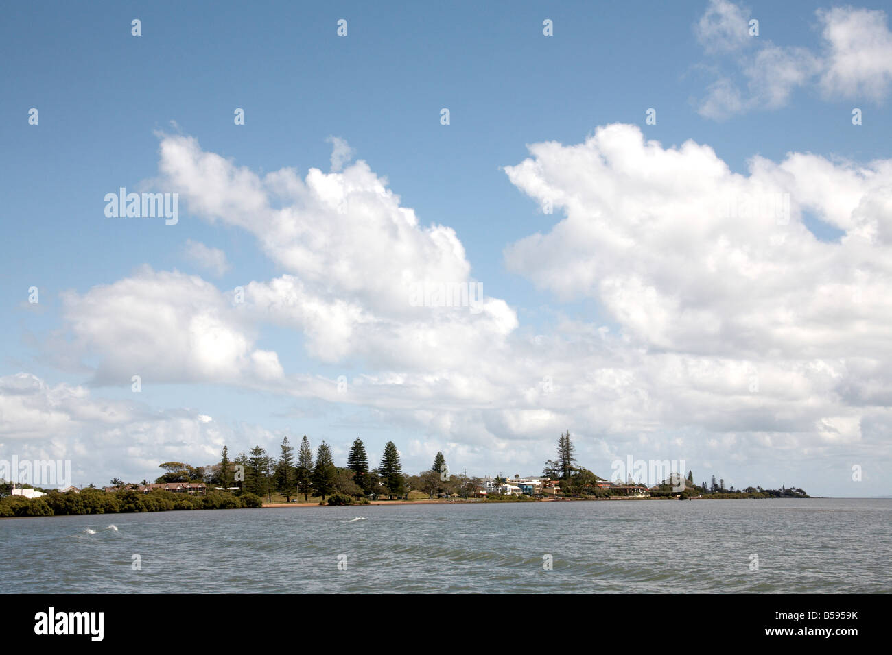 Shore St headland with sea and clouds Ormiston near Cleveland Brisbane Queensland QLD Australia - Stock Image