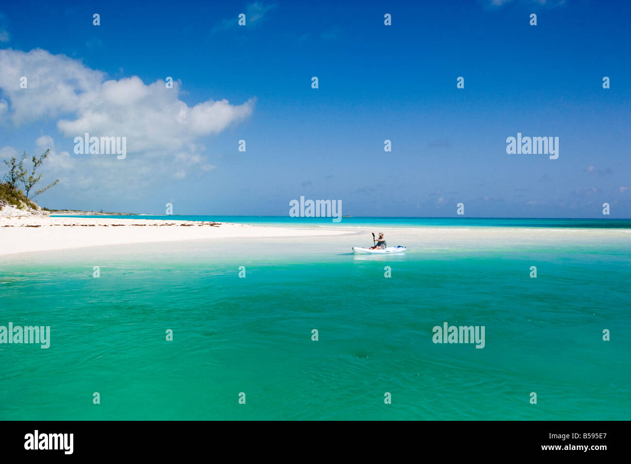 Crystal waters in the Bahamas Land Sea Park with kayak paddler - Stock Image