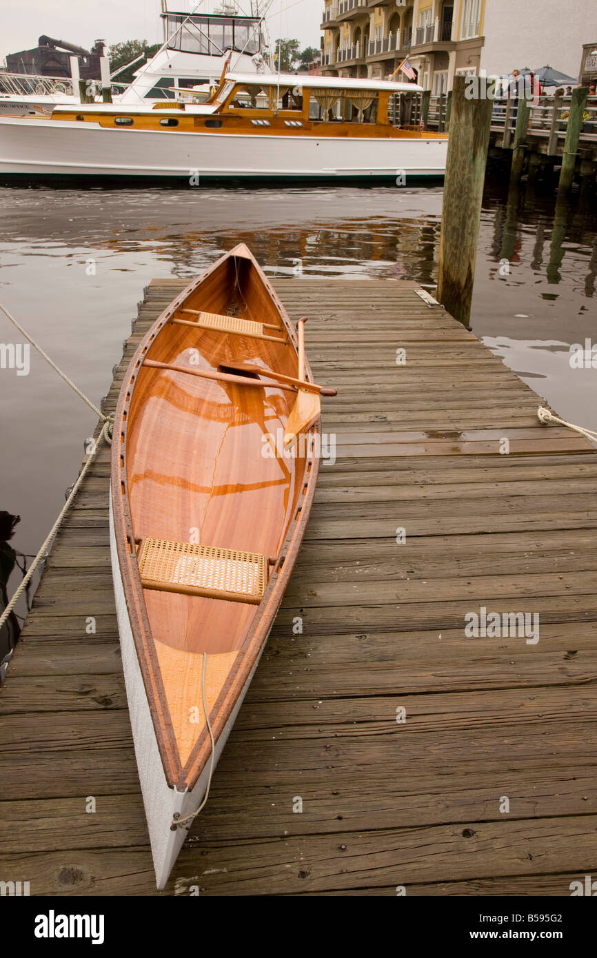 A wooden canoe lies on a dock in Georgetown South Carolina