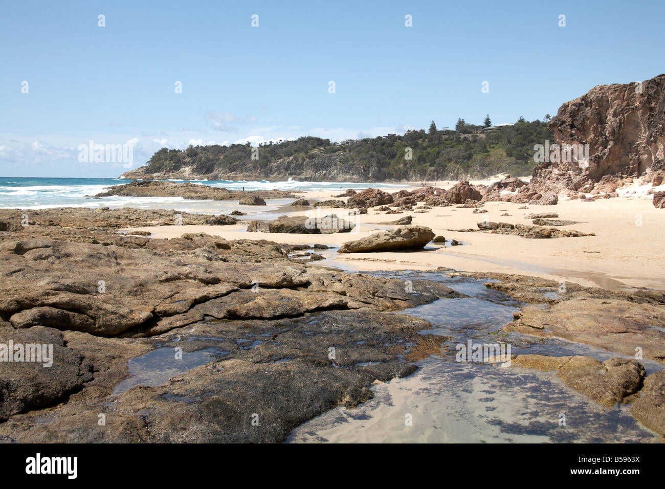 Rock pools and cliffs on Frenchmans beach North Stradbroke Island Queensland QLD Australia - Stock Image