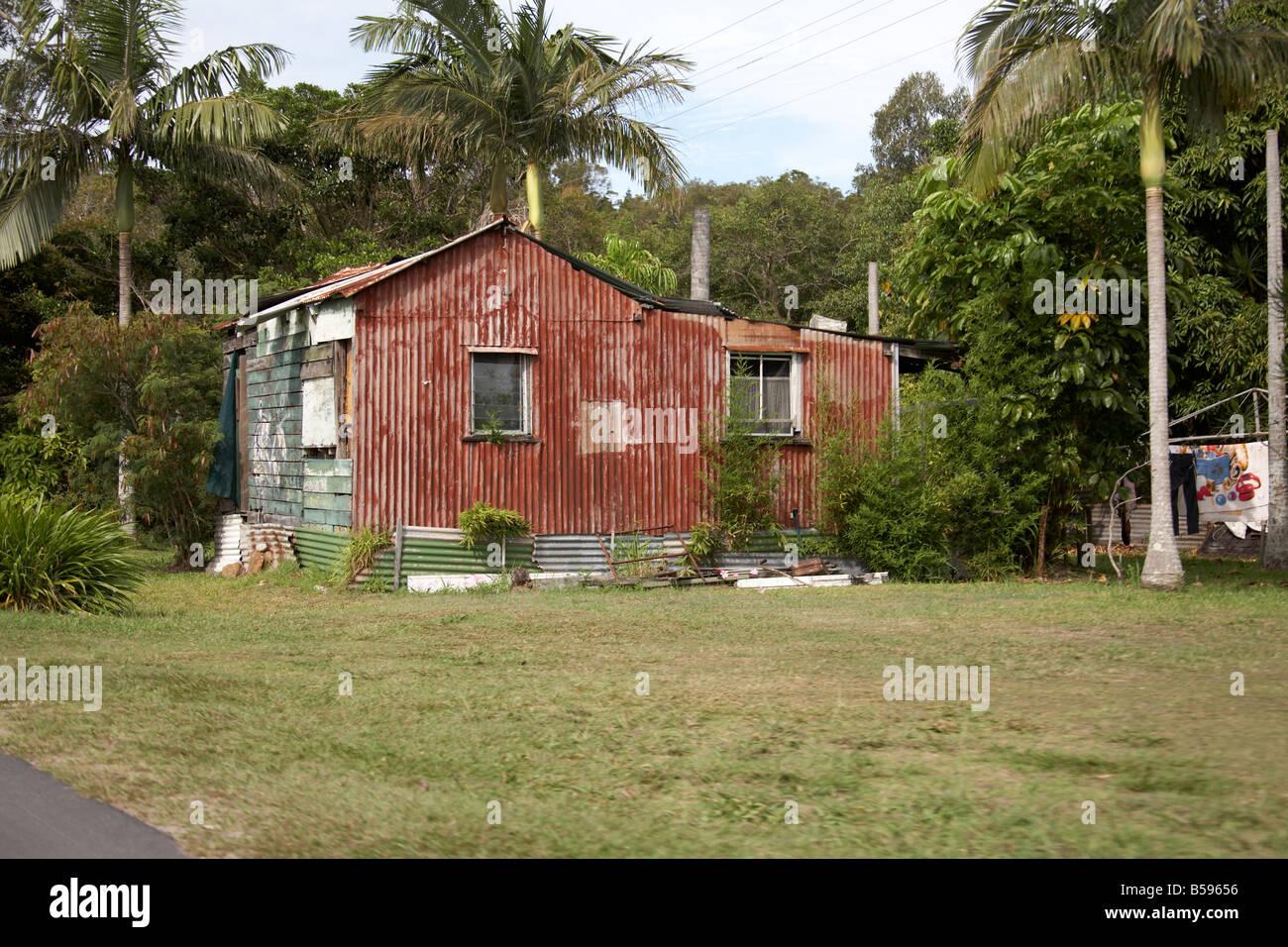 Aboriginal corrugated iron clad house on Stradbroke Island Queensland QLD Australia - Stock Image