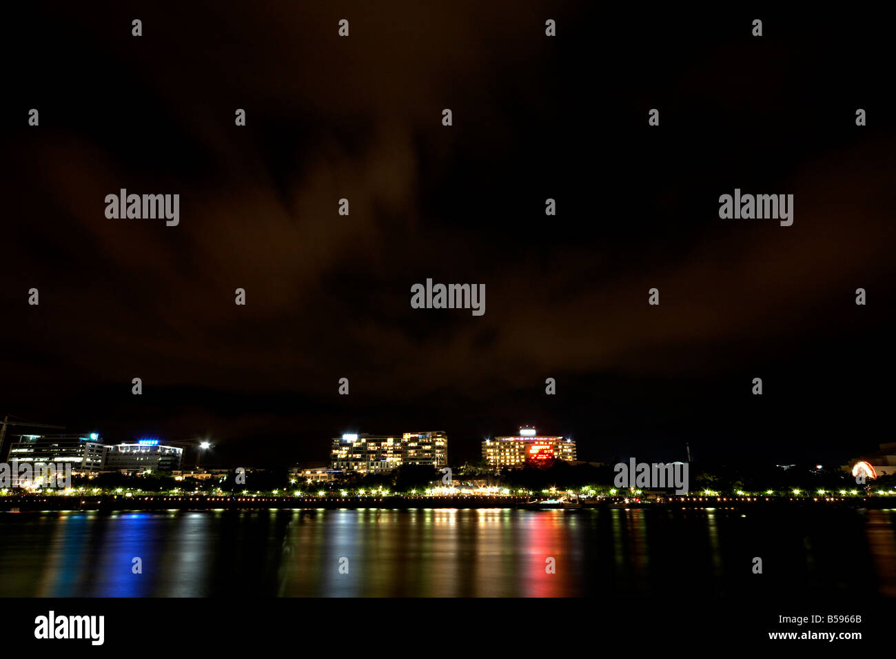 South Bank reflections in the Brisbane River at night in Brisbane Queensland QLD Australia - Stock Image