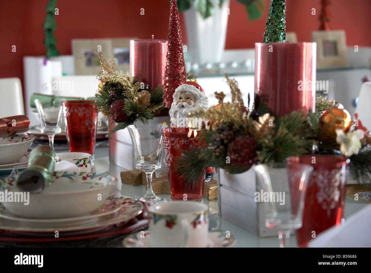 Table Laid With Christmas Decorations Tableware And Ornaments In
