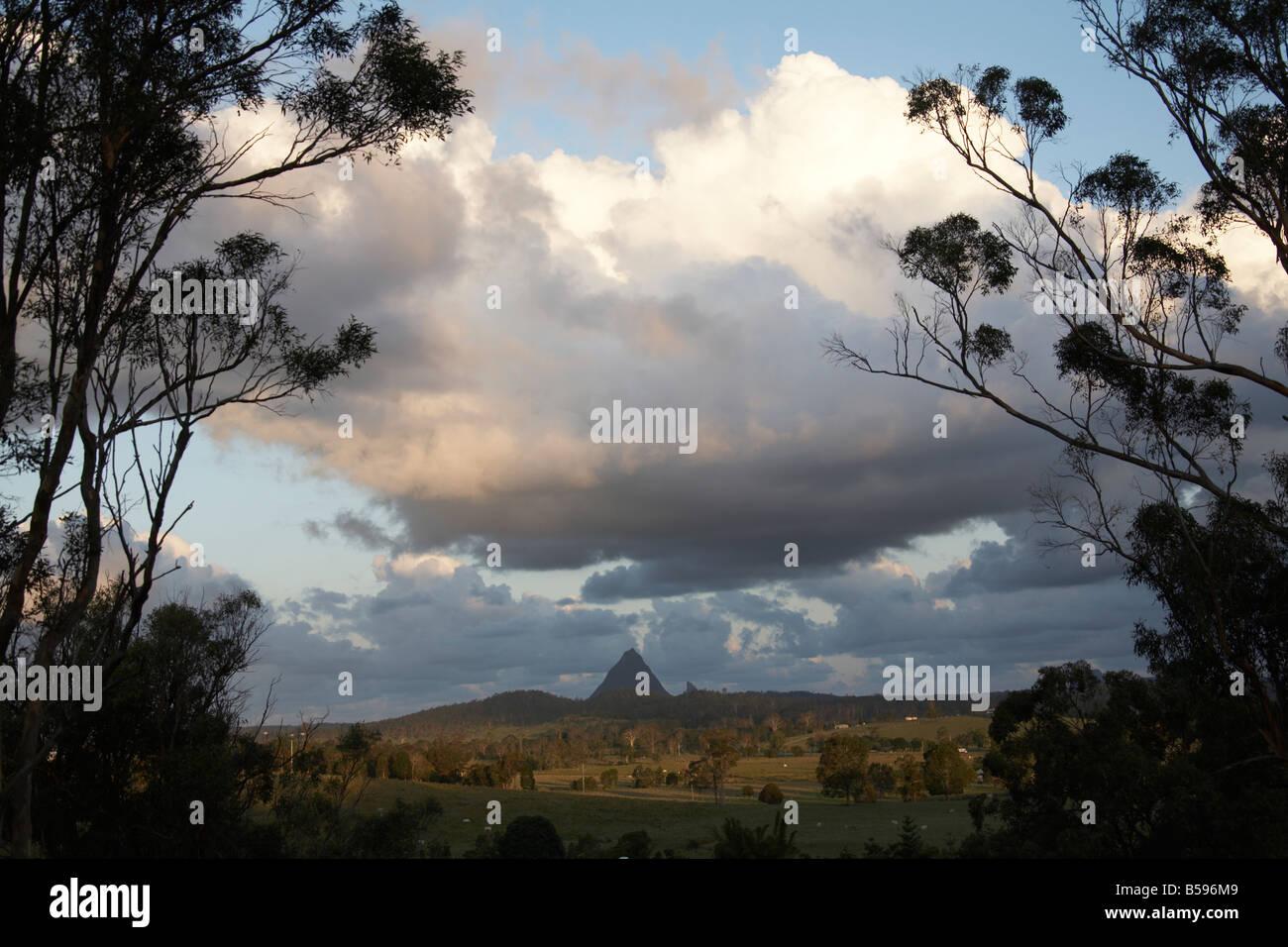 cumulus clouds mountains sunlight Queensland Australia - Stock Image