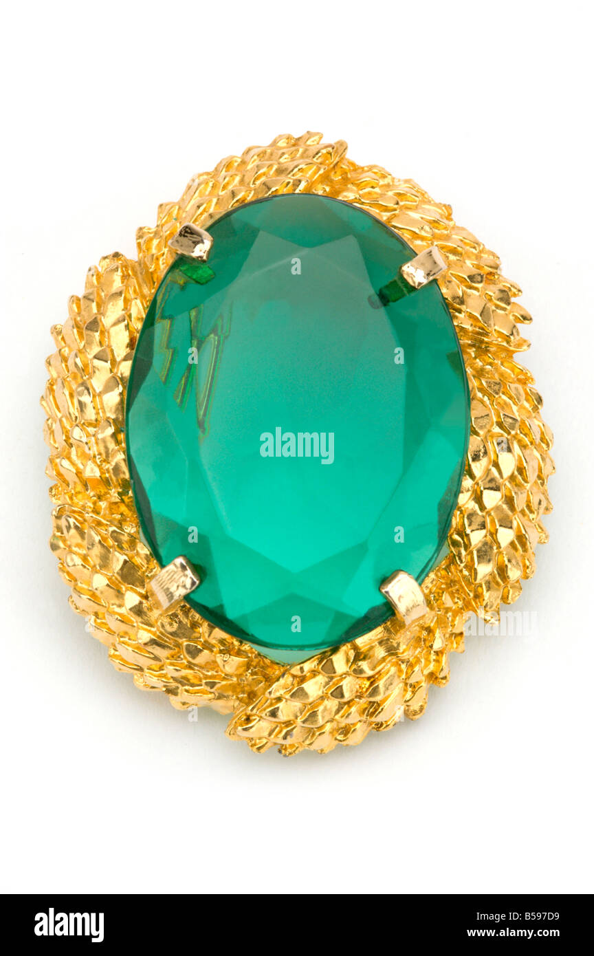 Green gem and gold costume jewellery on white  sc 1 st  Alamy & Green gem and gold costume jewellery on white Stock Photo: 20487077 ...