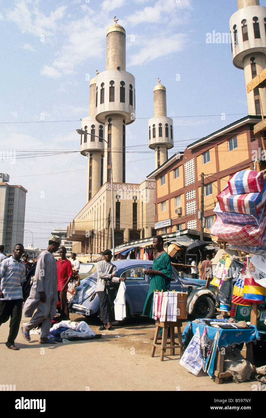 Mosque and people at a market in downtown Lagos Nigeria Africa - Stock Image