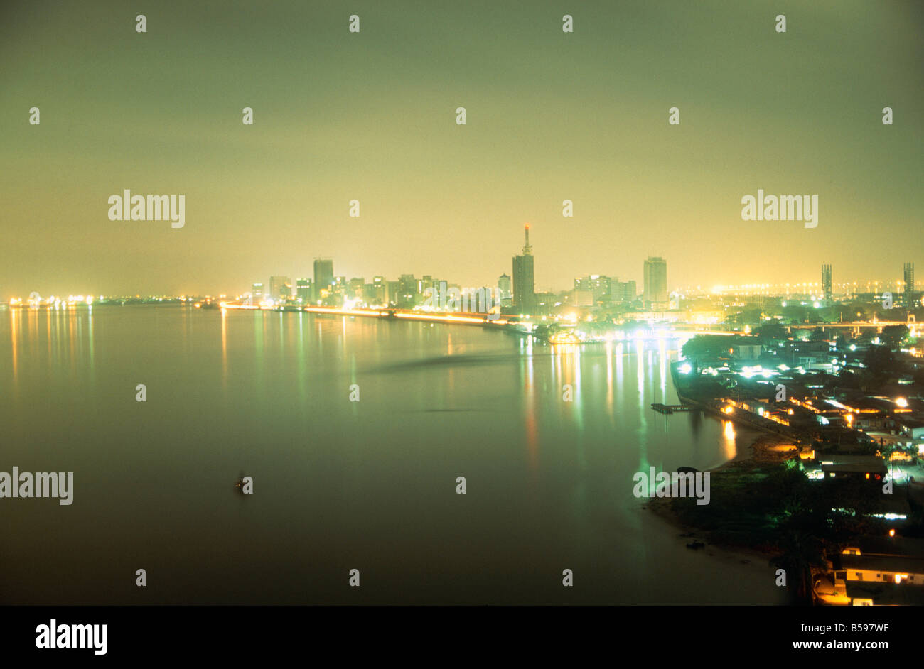 Ships in harbour at night in NNPC Nigerian National Petroleum Corporation oil refinery in Lagos Nigeria Africa - Stock Image