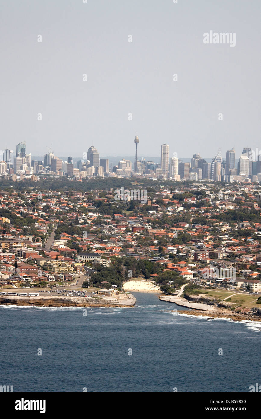 Aerial view north west of Coogee Bay city scyscrapers in distance Sydney NSW Australia High level oblique - Stock Image