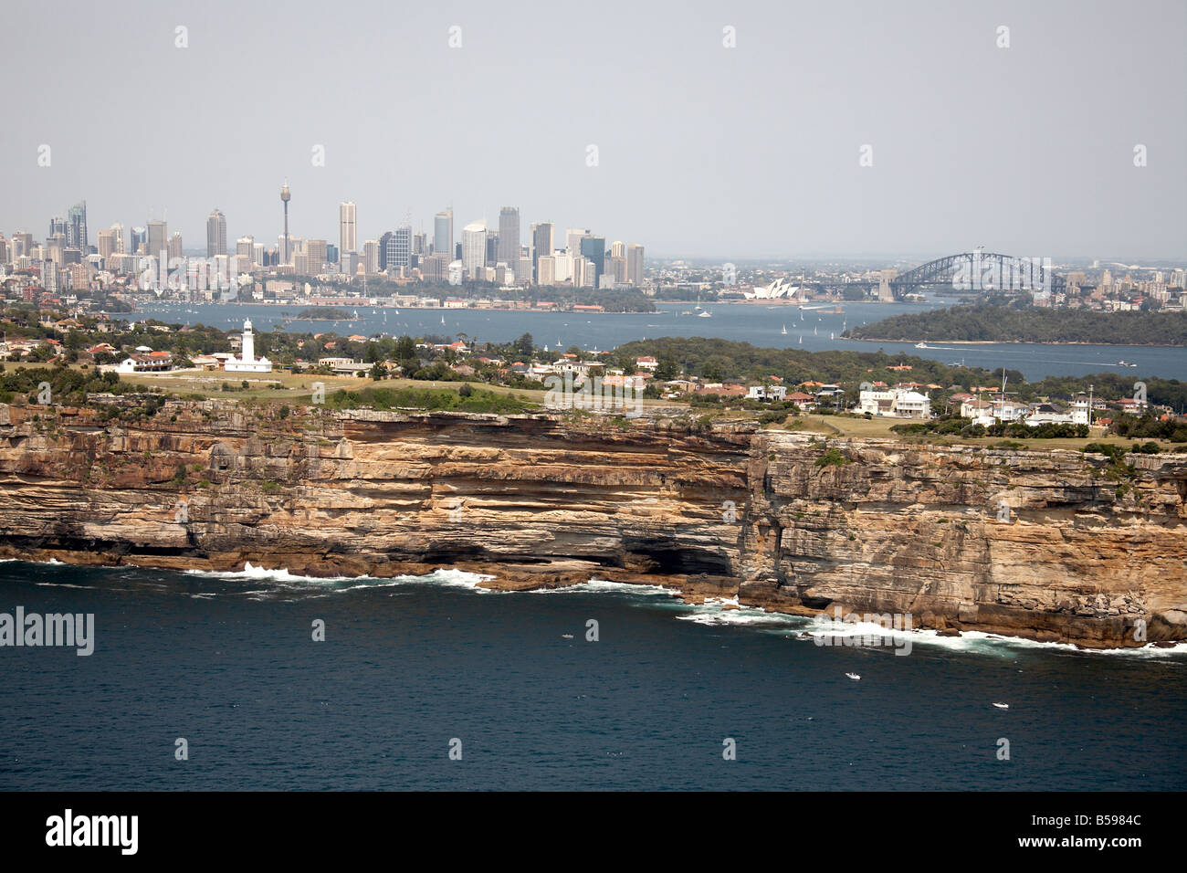 Aerial view south west of Gap Park Watsons Bay city skyscrapers and Harbour Bridge in distance Sydney NSW Australia - Stock Image