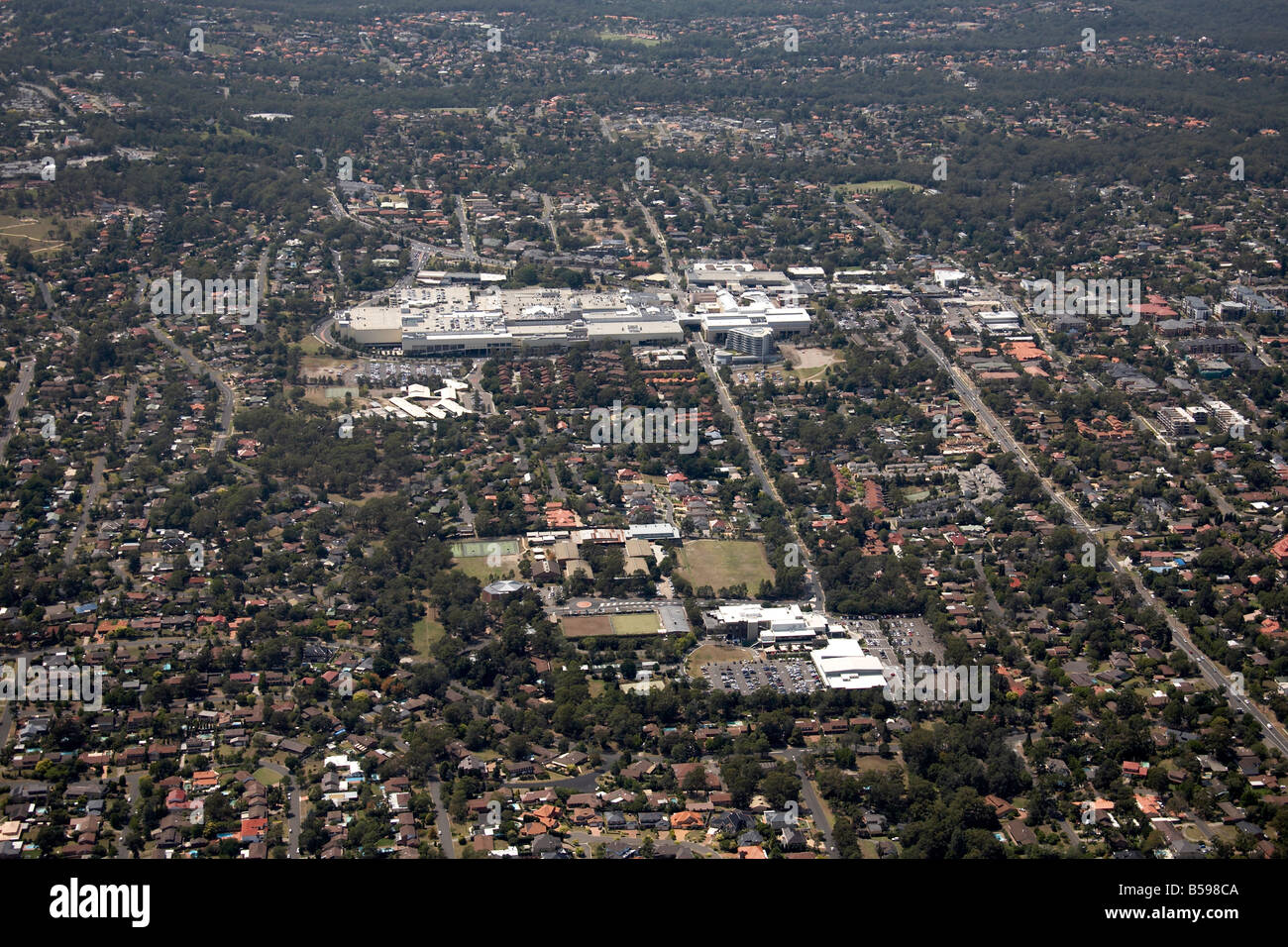 Aerial view south east of Castle Towers Shopping Centre RSL Showground Road suburban houses Seven Hills Sydney NSW - Stock Image