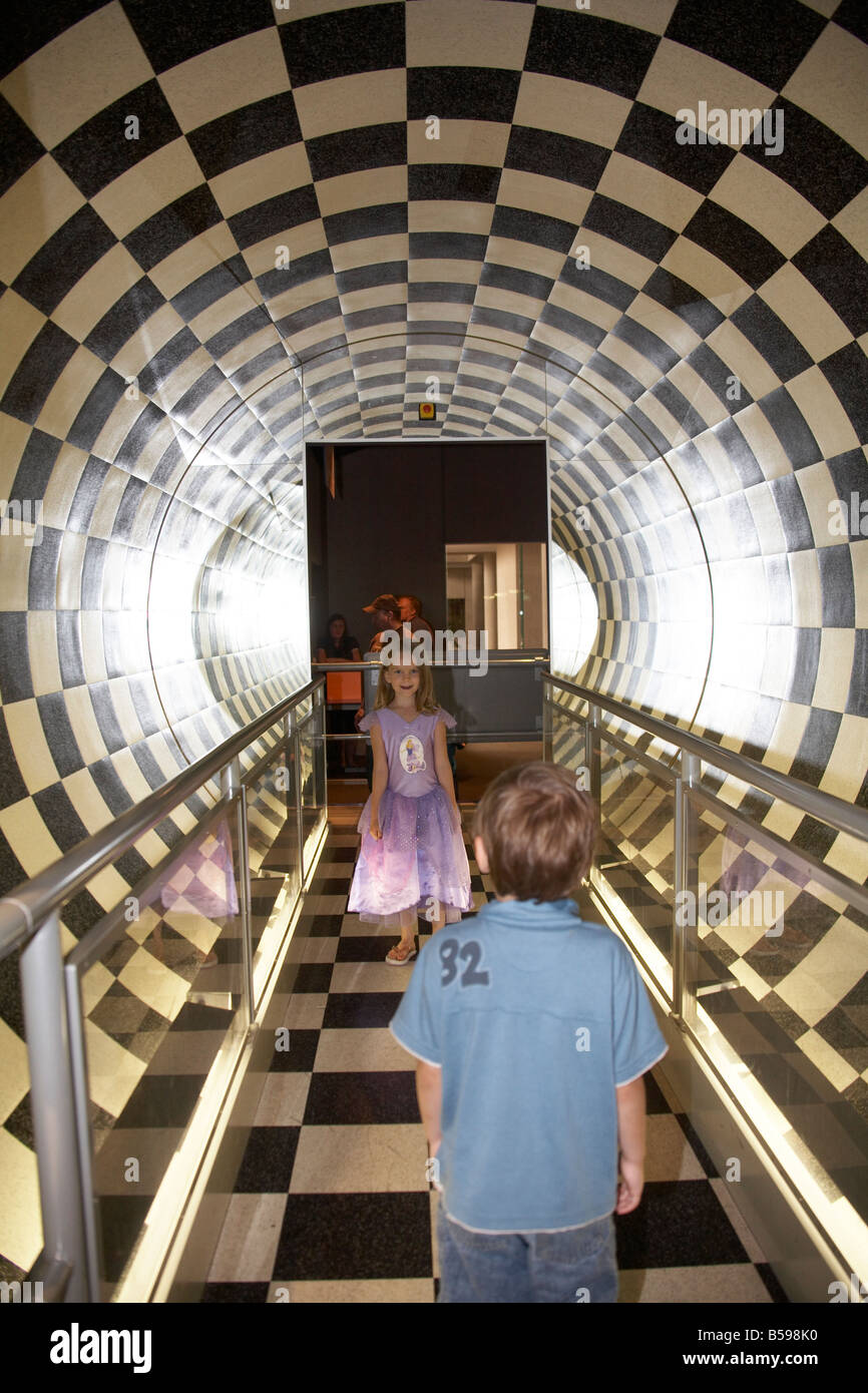 tube round room black white checkerboard two young children in Brisbane Queensland QLD Australia - Stock Image