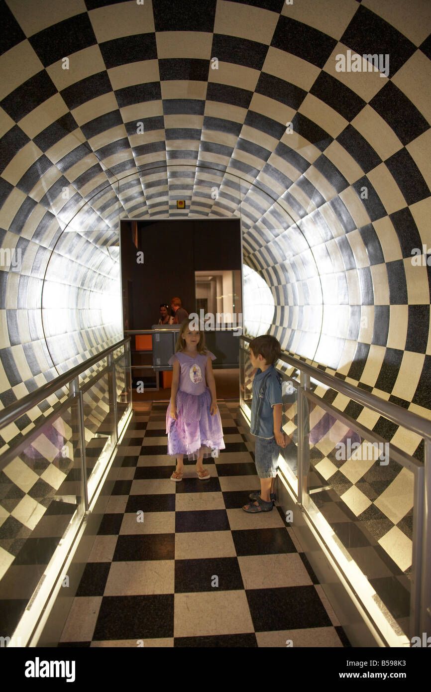 tube room black white checkerboard two young children in Brisbane Queensland QLD Australia - Stock Image
