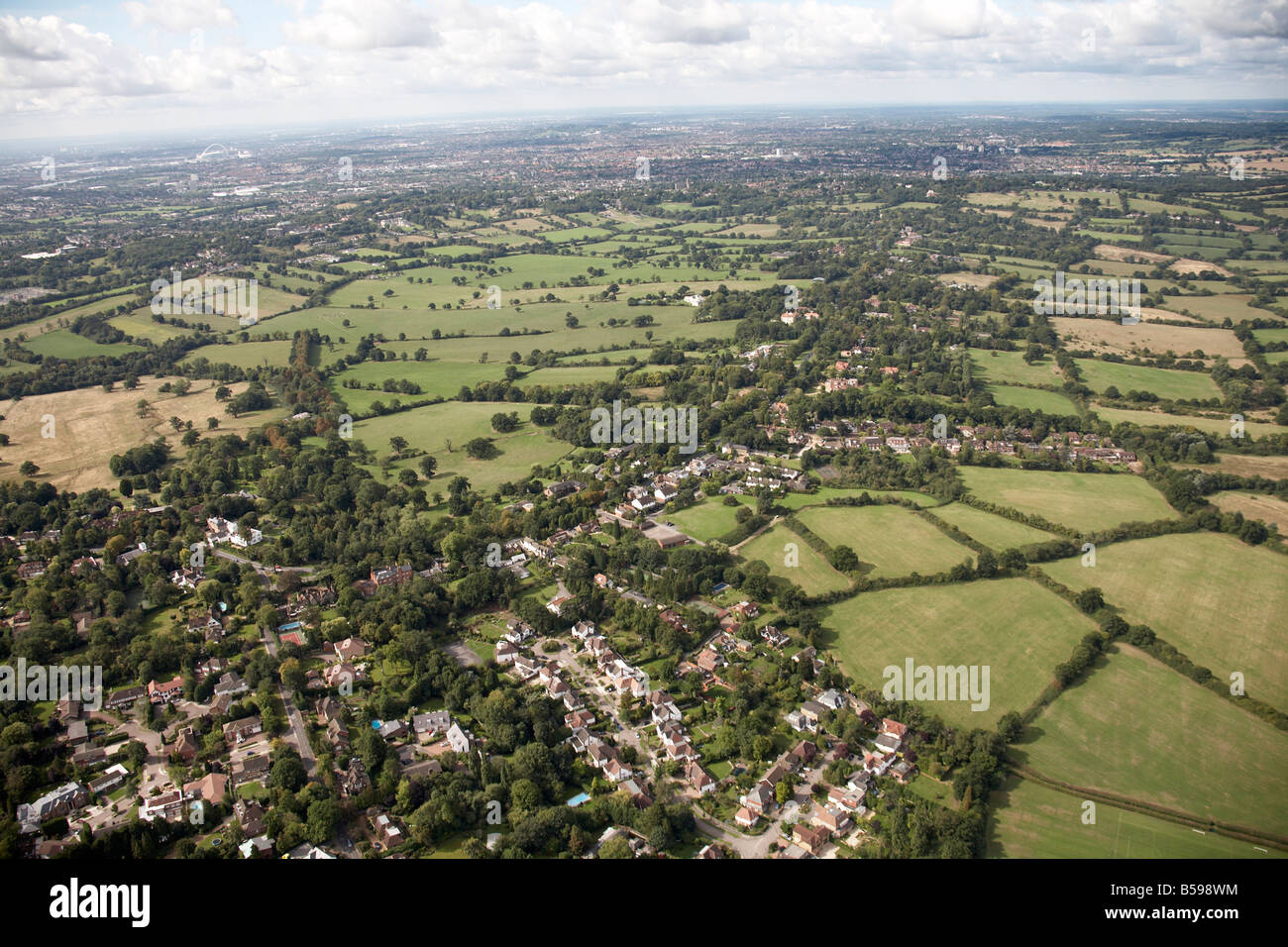 Aerial view south west of suburban houses fields trees Totteridge Common London N20 England UK - Stock Image