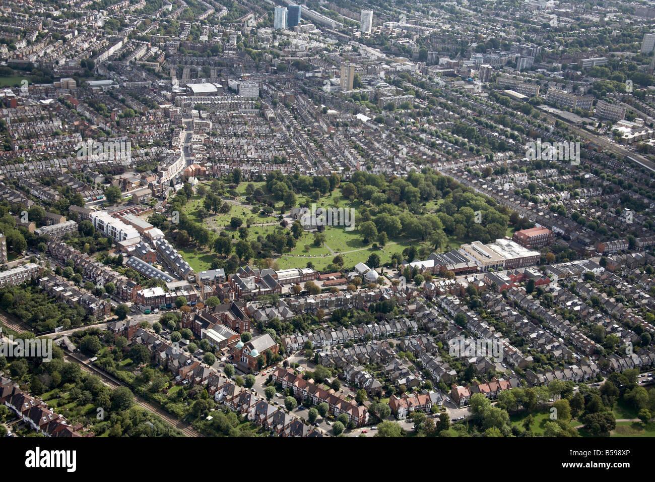 Aerial view north east of Willesden Lane Cemetery suburban houses tower blocks railway line Brondesbury London NW6 - Stock Image