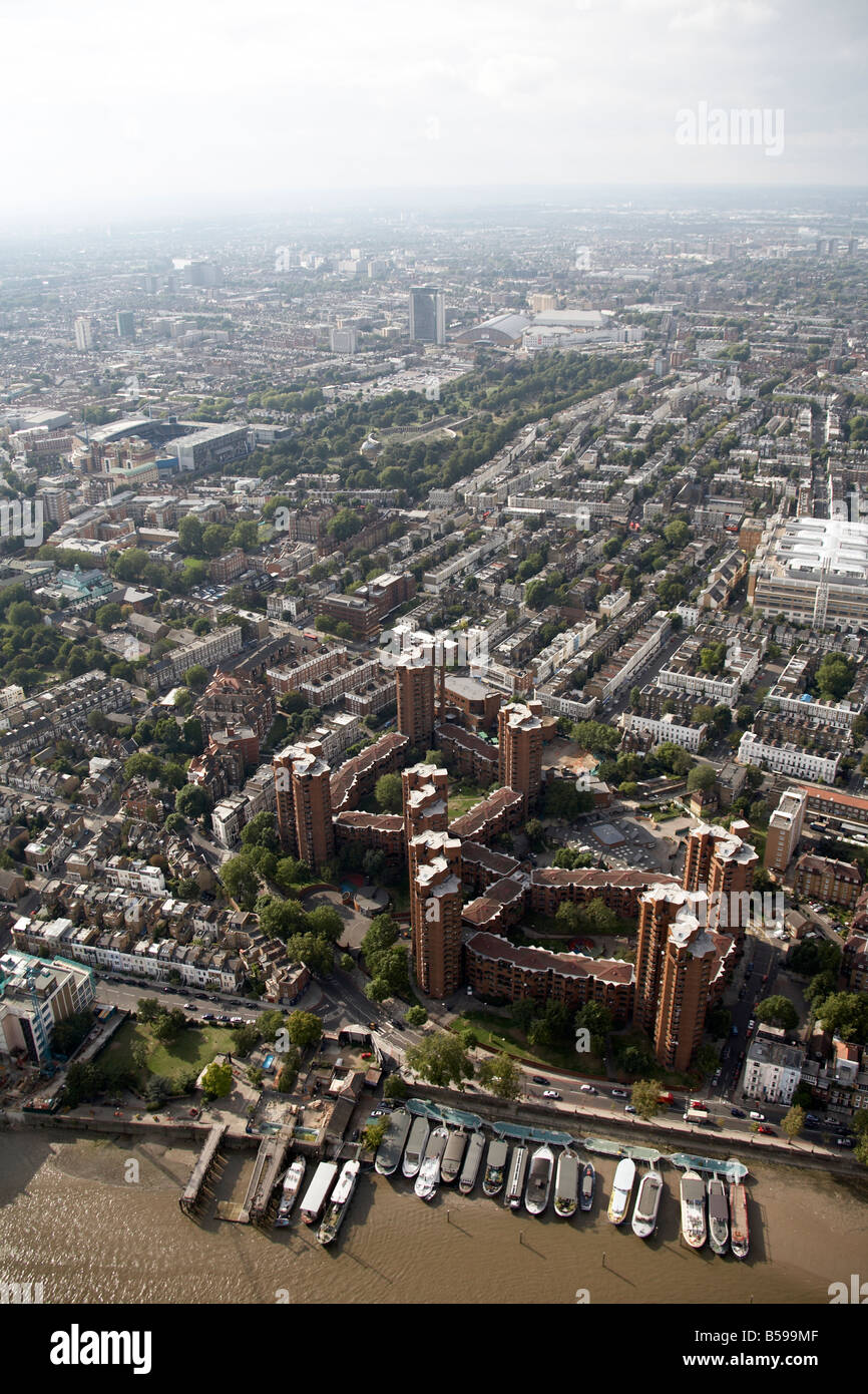 Aerial view north west of World s End Housing Estate tower blocks Cheyne Walk River Thames house boats West Brompton - Stock Image