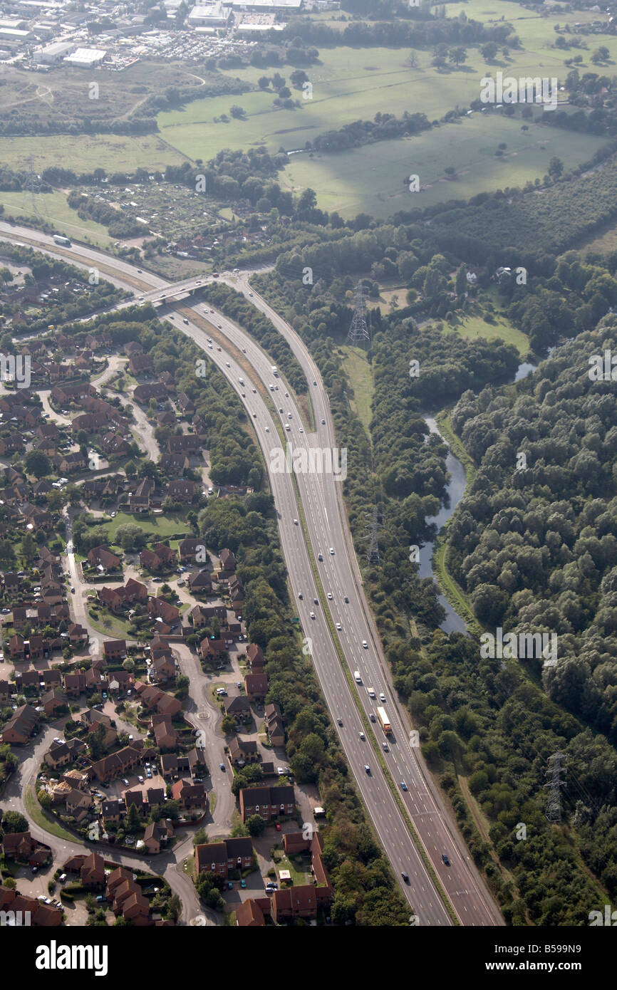 Aerial view north west of London Road A3 Road Clay Lane River Wey Navigation N T Sutton Park suburban houses Guildford - Stock Image