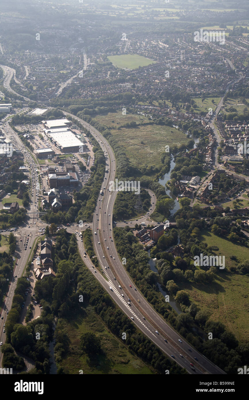 Aerial view west of London Road A3 Rd Woking Rd suburban houses River Wey Navigation N T Ladymead Retail Park Guildford - Stock Image
