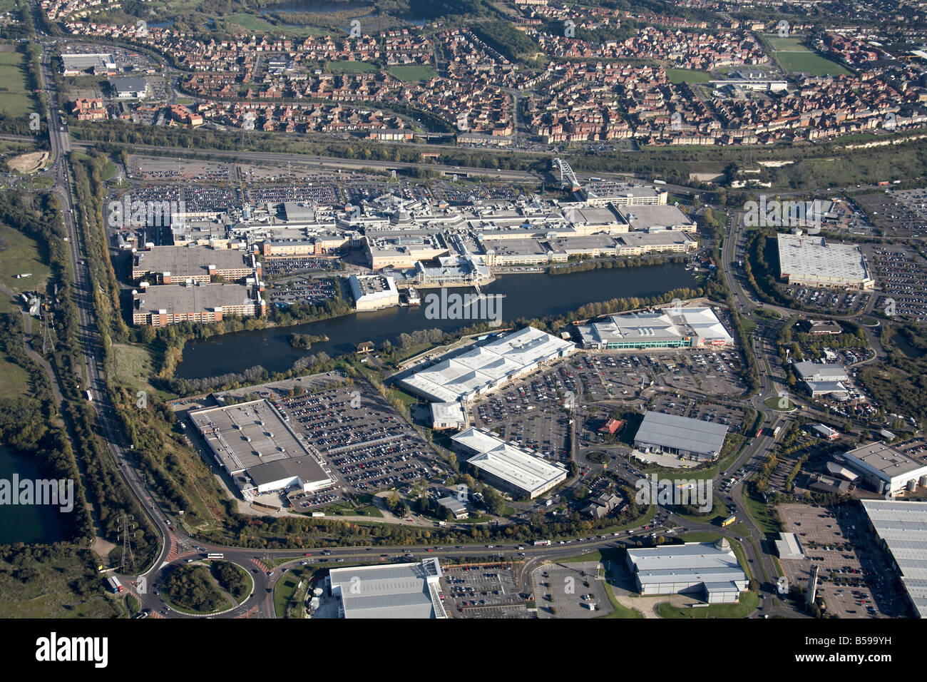 Aerial view east of Thurrock Lakeside Shopping Centre Alexandra Lake Lakeside Retail Park suburban houses Arterial - Stock Image