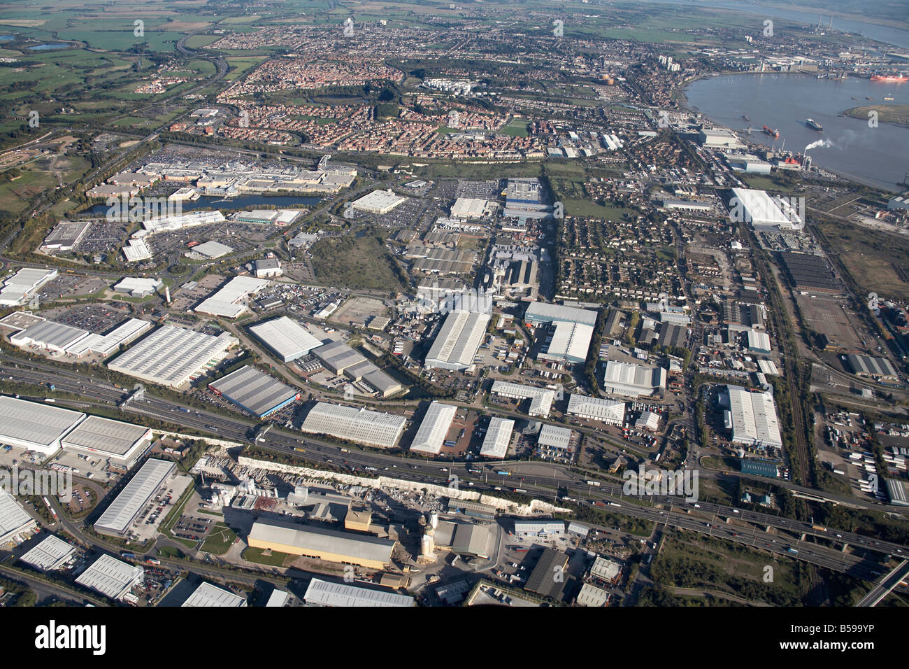 Aerial view south east of industrial estates retail parks Canterbury Way suburban houses River Thames West Thurrock - Stock Image