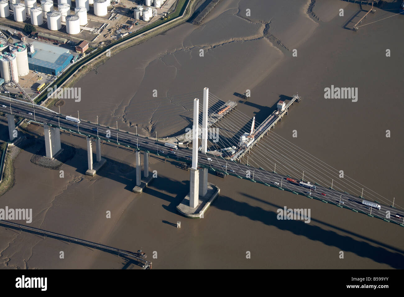 Aerial view south east of Queen Elizabeth II Bridge jetties River Thames oil storage depot West Thurrock Grays London - Stock Image