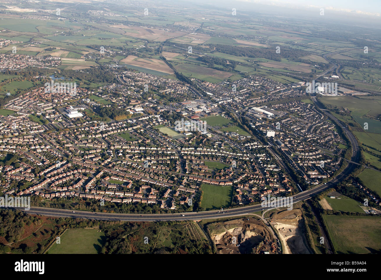 Aerial view south east of suburban houses Swanley By Pass Road A20 railway line playing fields country fields Bromley - Stock Image