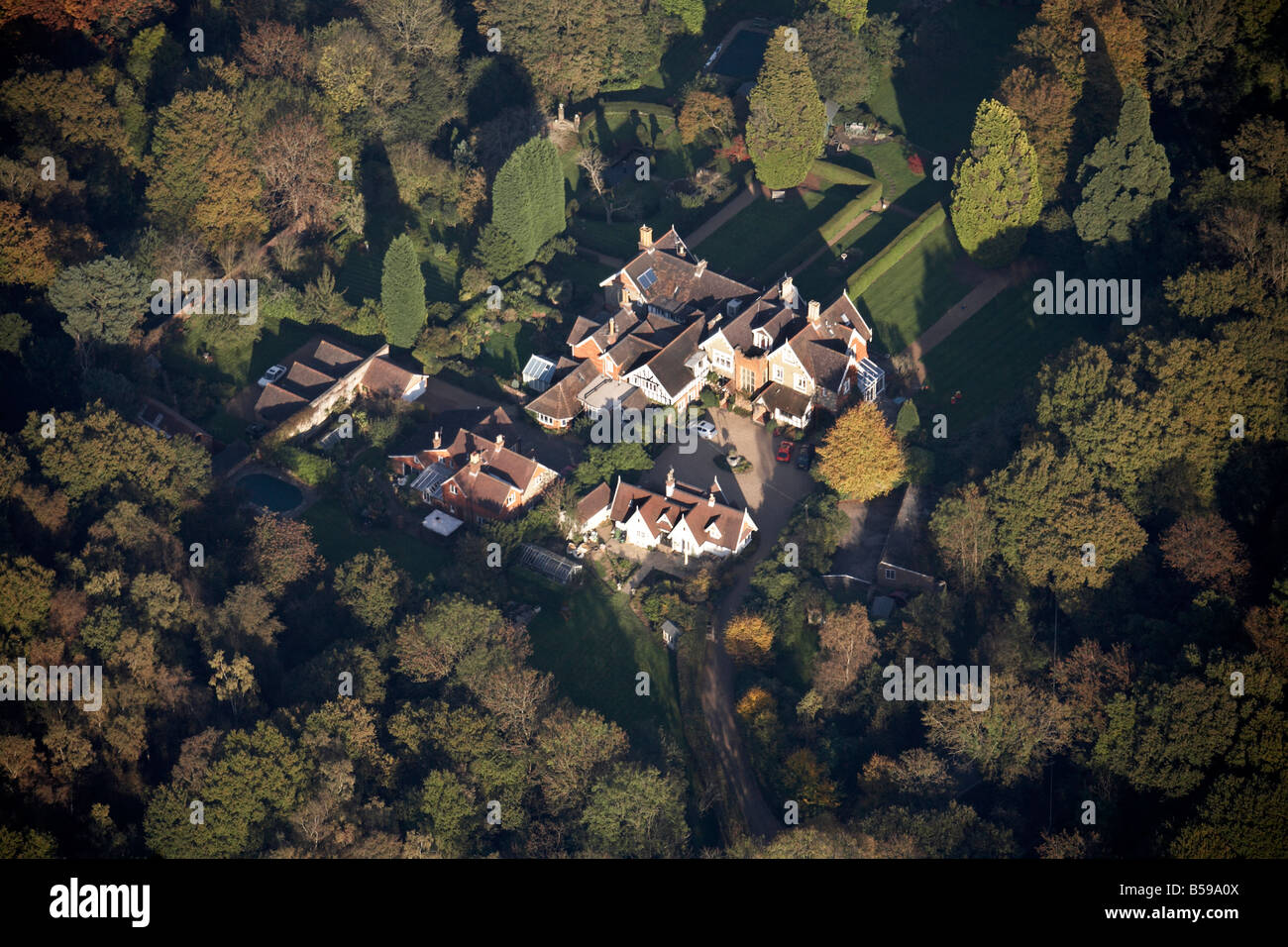 Aerial view east of country houses gardens trees Capel Surrey RH5 England UK - Stock Image