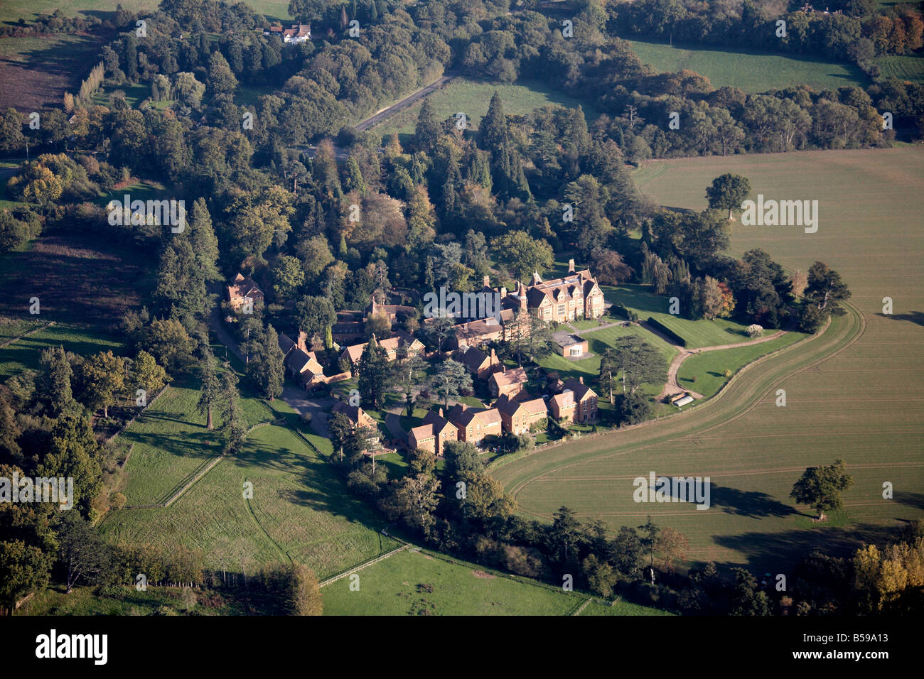 Aerial view east of country houses fields trees West Sussex RH12 England UK - Stock Image