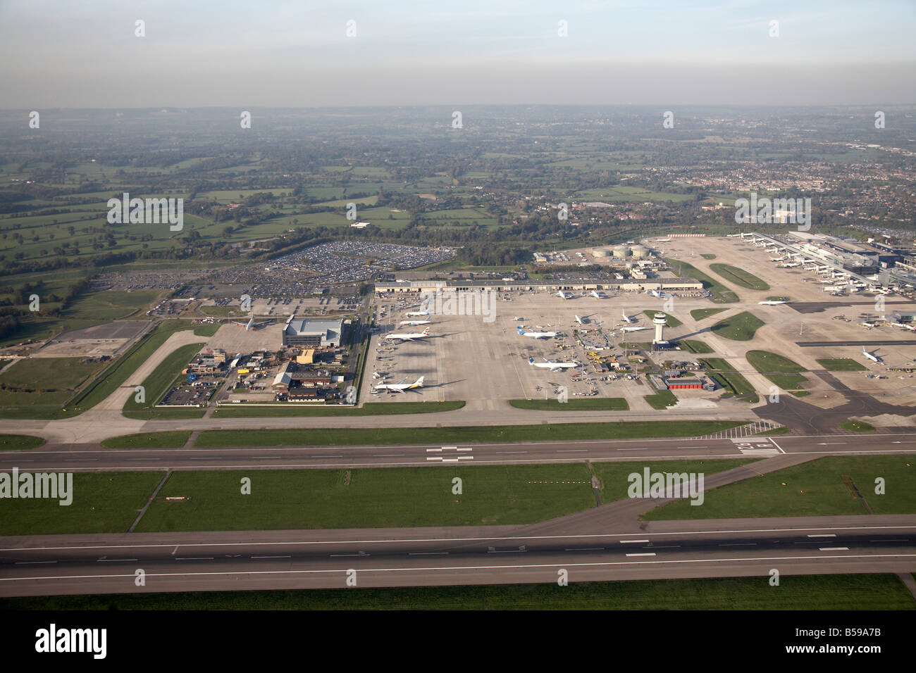Aerial view north west of London Gatwick Airport runways aeroplanes country fields Crawley West Sussex RH6 England Stock Photo