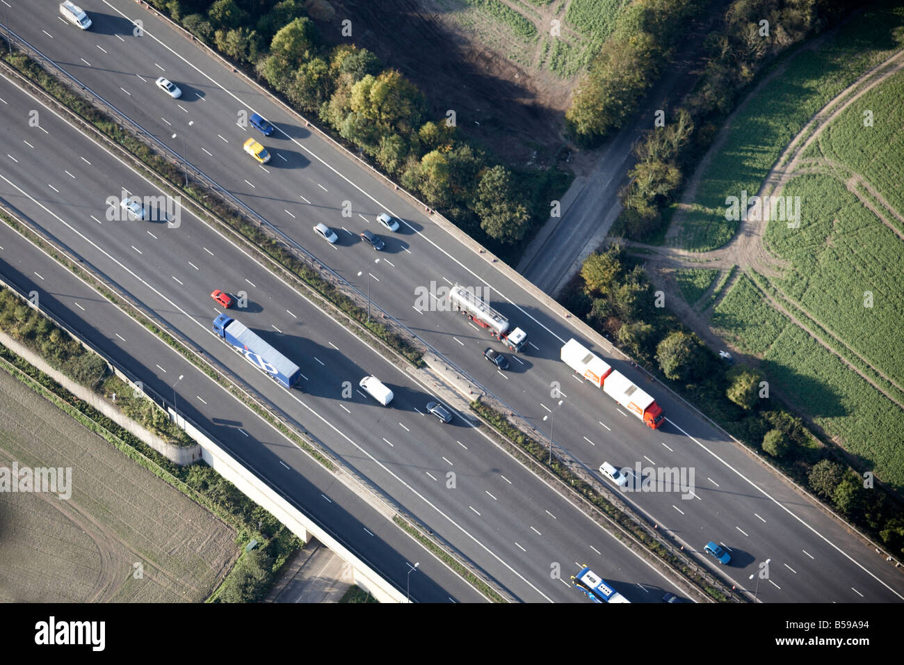 Aerial view north west of M25 Motorway Markedge Lane lorries country fields Reigate Surrey RH1 England UK - Stock Image