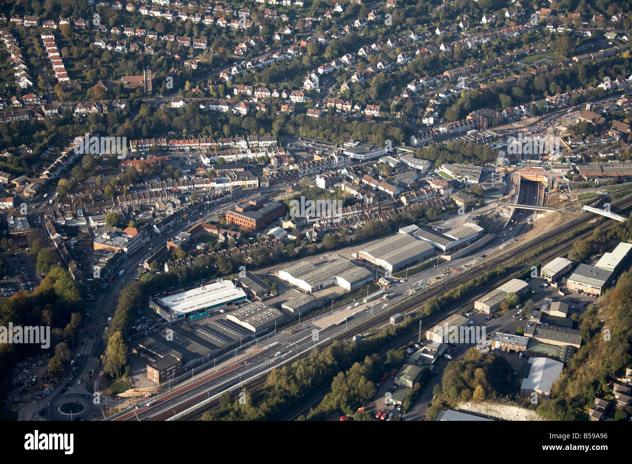Aerial view north west of Brighton Road railway line Coulsdon North Industrial Estate depot suburban houses Croydon - Stock Image