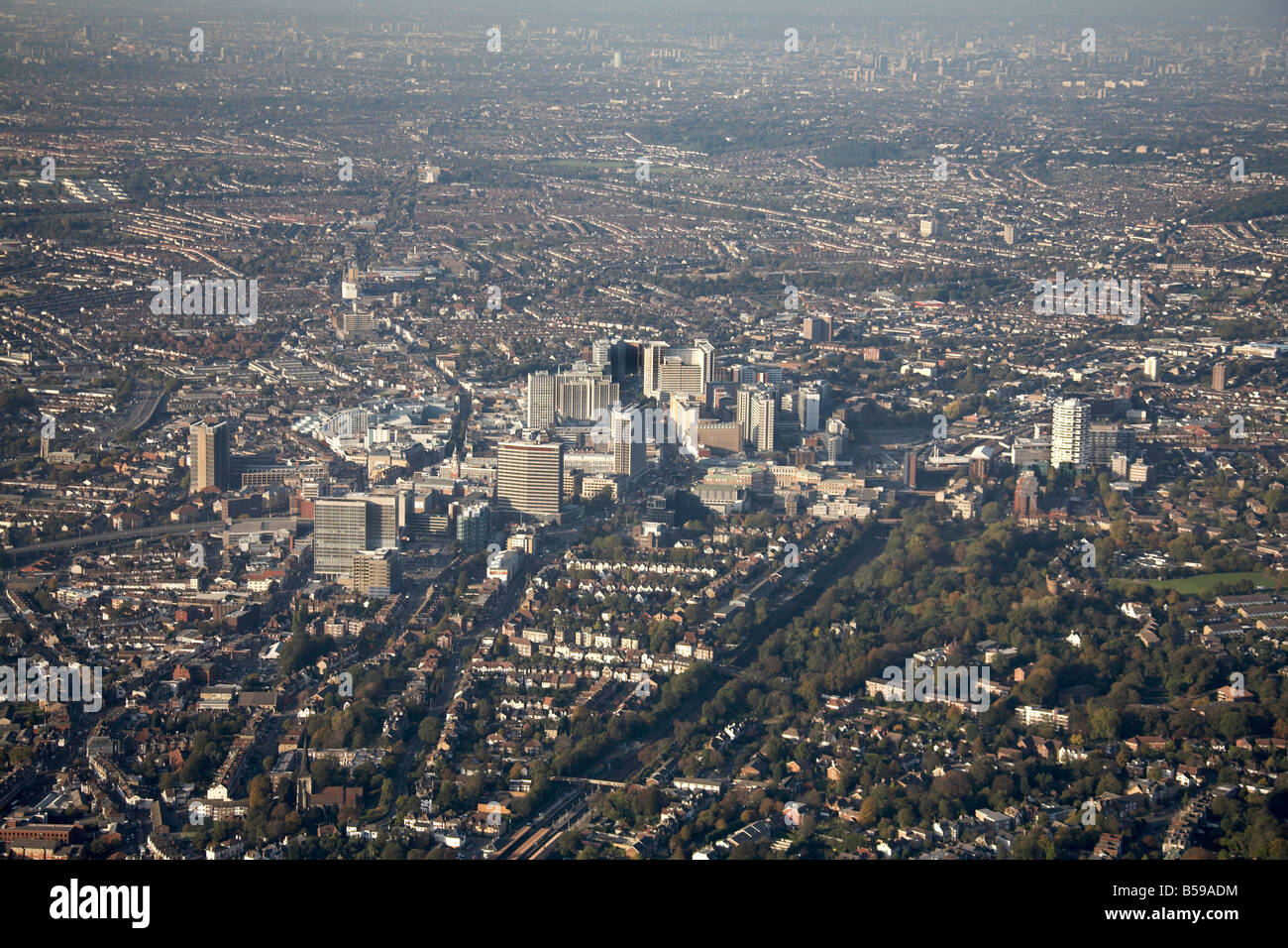 Aerial north west of Croydon Town Centre tower blocks The Croydon Flyover suburban houses railway line Greater London - Stock Image