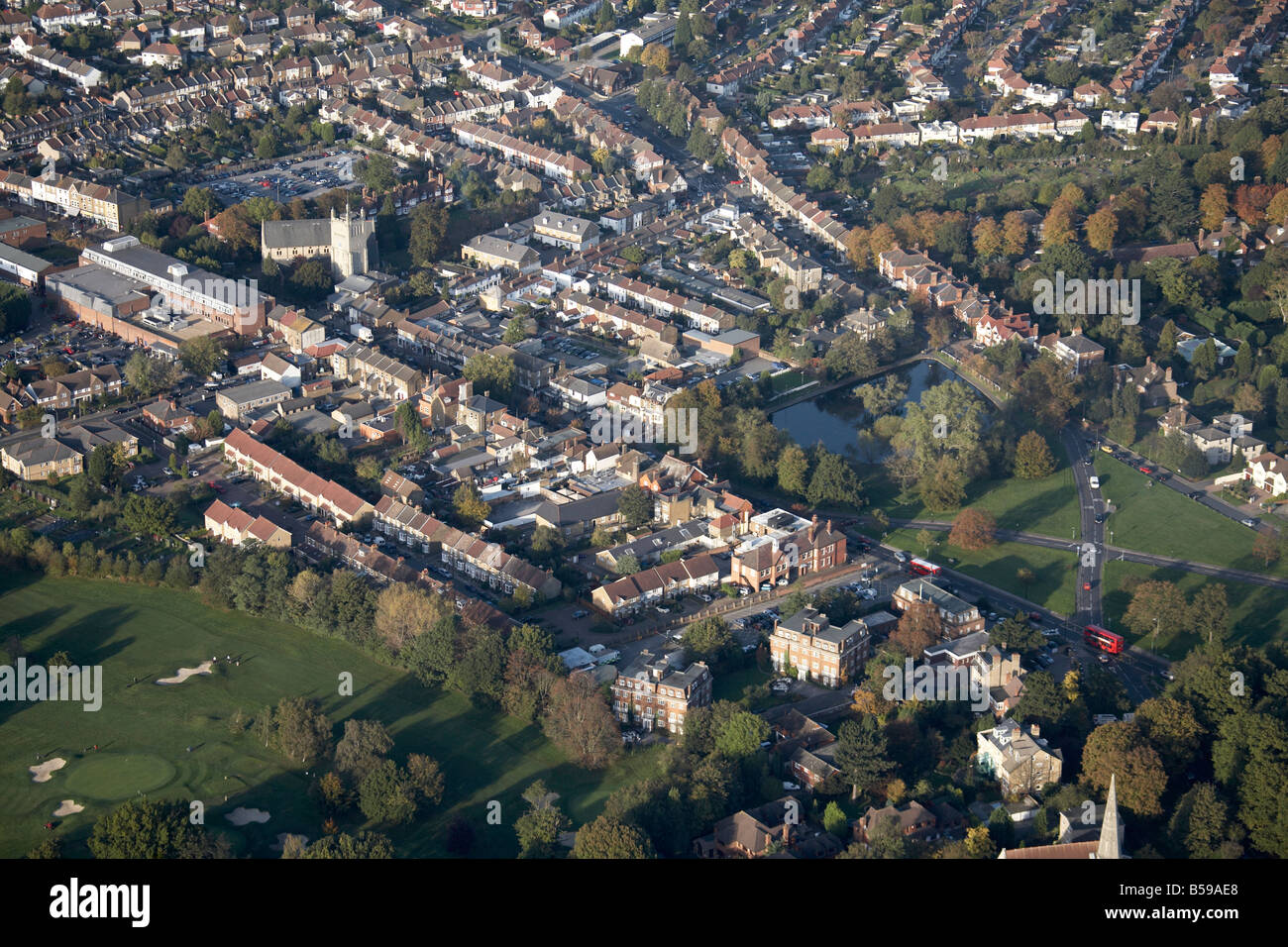 Aerial view north east of Chiselhurst High Street town centre recreation ground lake suburban houses Greater London - Stock Image