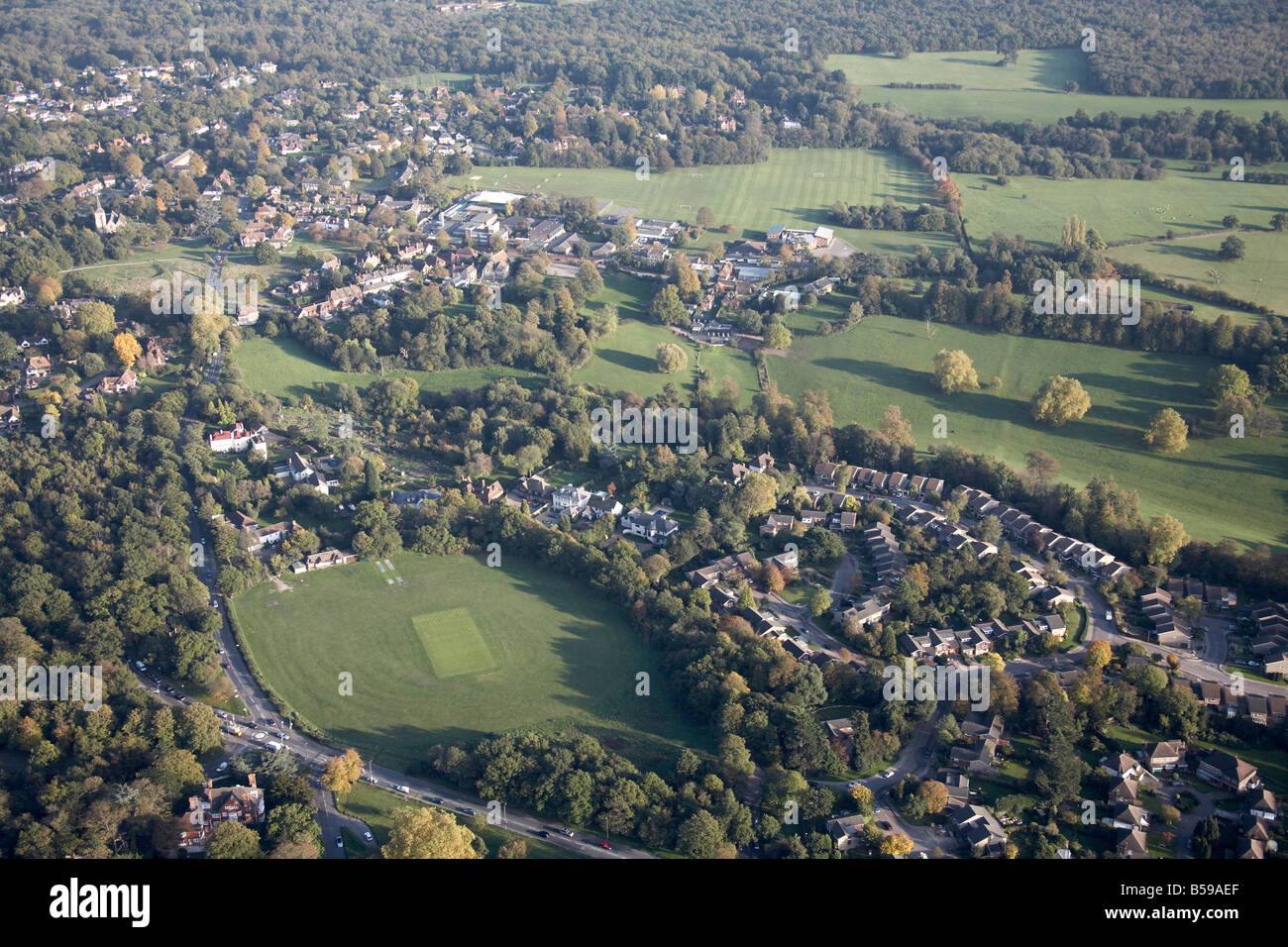 Aerial view south east of cricket ground Bansome Wood suburban houses Watt s Lane Norlands Crescent Bromley London - Stock Image