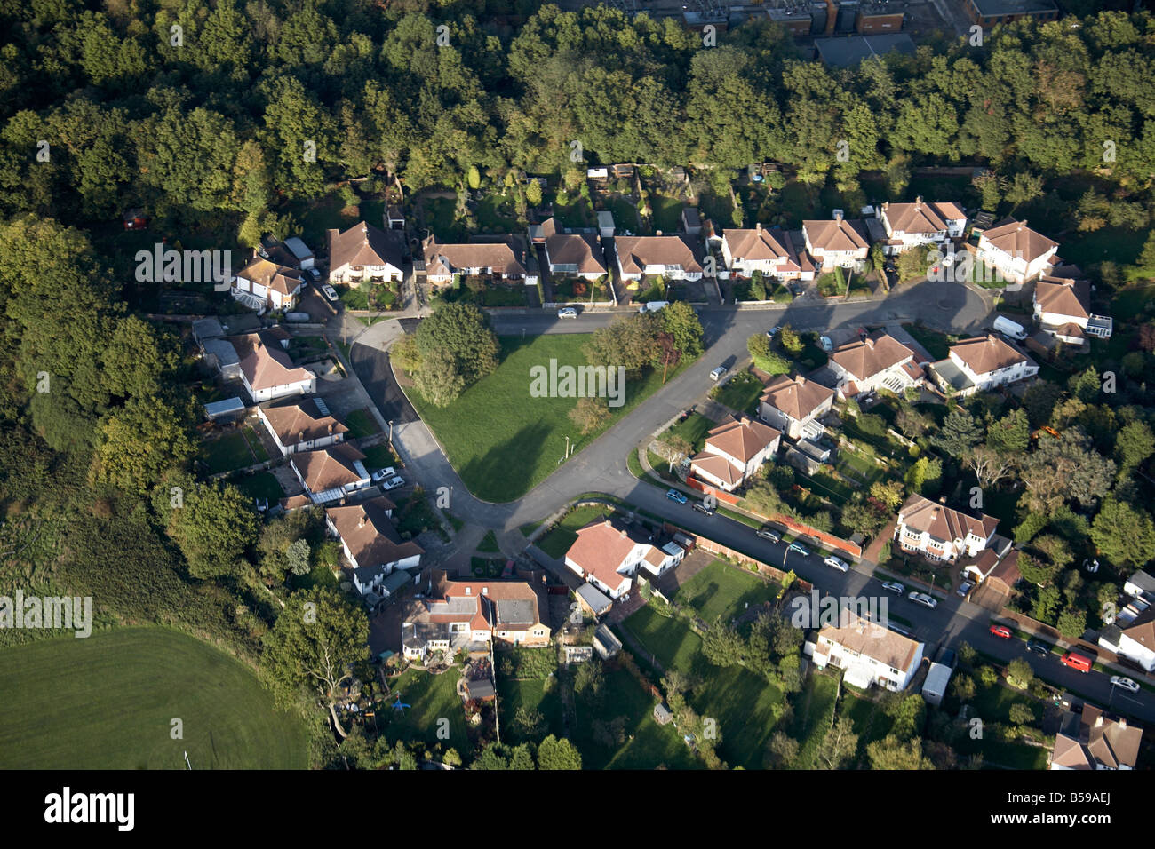 Aerial view north east of suburban housing estate Merton Gardens Crest View Drive gardens trees sports grounds Bromley - Stock Image