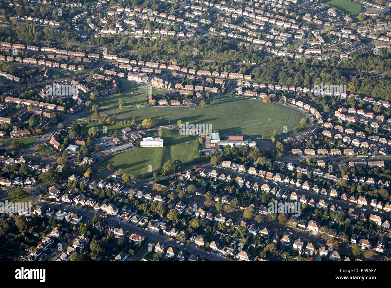 Aerial view north west Poverest Primary School playing fields suburban houses Cray Valley Road Friar Road Orpington - Stock Image