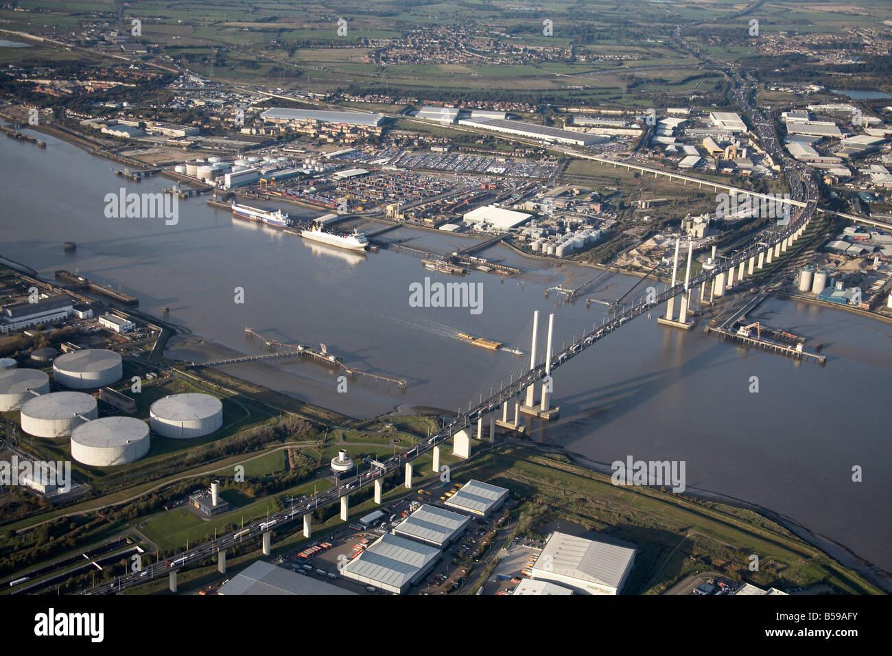 Aerial view north east of River Thames jetties Queen Elizabeth II Bridge gas works Dartford Purfleet Deep Wharf - Stock Image