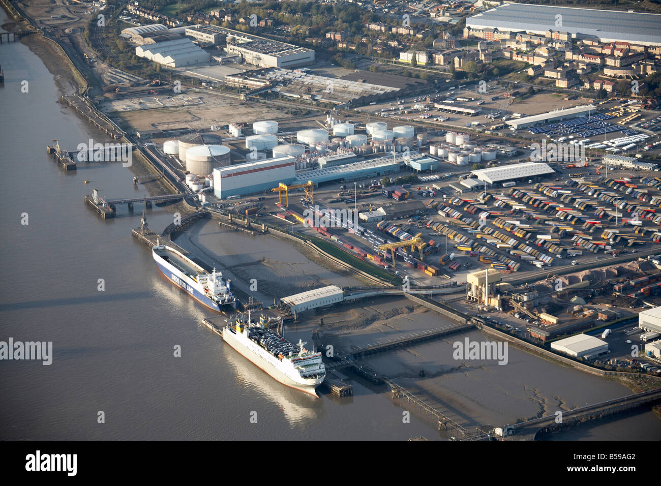 Aerial view north west Purfleet Deep Wharf mills storage containers DLR railway line River Thames jetties Thurrock - Stock Image