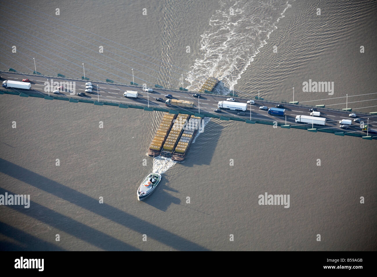 Aerial view north west of Queen Elizabeth II Bridge River Thames boat cargo water ripples Dartford London DA1 England - Stock Image